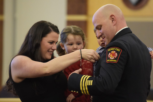 TIM JEAN/Staff photo <br /> <br /> Derry Fire Battalion Chief Shawn Haggart, right, has his badge pinned on by his wife Rebecca, as their children Makayla, 3, and Calvin, 1, look on during a Promotional Ceremony at the Derry Municipal Center.   11/21/19