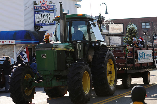 TIM JEAN/Staff photo <br /> <br /> A tractor from J & F Farms in Derry, pulls its float with animals during the Annual Nutfield Holiday Parade in Derry, NH.     11/30/19