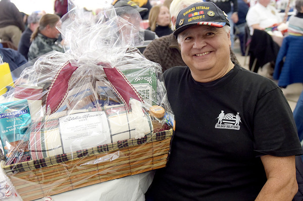 TIM JEAN/Staff photo <br /> <br /> Andy Durning, of Londonderry, an Air Force DAV, is all smiles after receiving a basket during a Veterans Breakfast at Londonderry High School.    11/9/19
