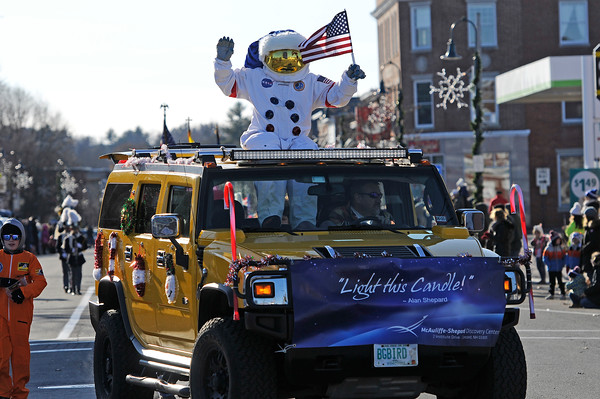 TIM JEAN/Staff photo <br /> <br /> An astronaut waves to the crowd as he pokes out the sunroof of a large SUV from the McAuliffe- Shepard Discovery Center in Concord during the Annual Nutfield Holiday Parade in Derry, NH.     11/30/19
