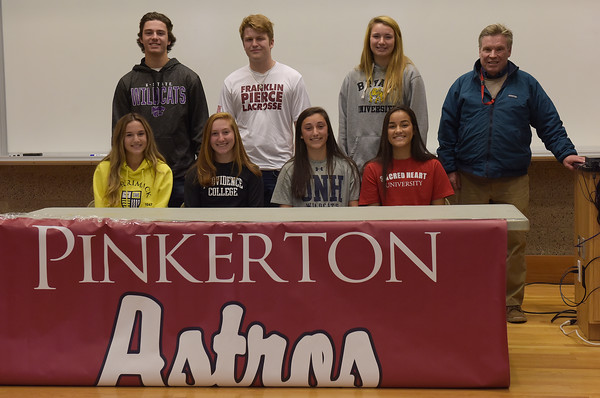 TIM JEAN/Staff photo <br /> <br /> Pinkerton Academy's Hampstead students pose with their former physical education teacher Paul Cournoyer, right, of Hampstead Middles School during a letter of intent for college signing at Pinkerton Academy. Students standing from  left to right, Brady Day, baseball; Kansas State, Connor McCormack, lacrosse; Franklin Pierce, Lily Auger, lacrosse; Bryant, sitting from left to right, Kate Bennett, field hockey; Merrimack College, Marley Mailoux, field hockey; Providence, Mari Shea, field hockey; UNH and Sarah Collins, field hockey; Sacred Heart University.       11/14/19