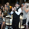CARL RUSSO/Staff photo Dinner guest, dressed appropriately for the chamber dinner theme, ''Roaring Into the 20's'', applaud the award recipients. The Greater Derry and Londonderry Chamber of Commerce held their 2019 annual award dinner Thursday night at the Birch wood vineyards.10/03/2019