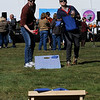 TIM JEAN/Staff photo<br /> <br /> David Johnson, left, of Derry, and Woody Hedberg, of Somerville, MA., play a game of corn-hole during the Derry Village Rotary Club's second annual Oktoberfest. The event was held at the Boys & Girls Club of Greater Derry.  10/5/19