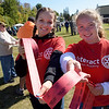 TIM JEAN/Staff photo<br /> <br /> Emily DiGiacomo, left, and Isabella Woods, both 16, from Pinkerton Academy's Interact Rotary Club sold raffle tickets during the Derry Village Rotary Club's second annual Oktoberfest. The event was held at the Boys & Girls Club of Greater Derry.  10/5/19