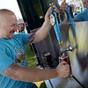 TIM JEAN/Staff photo<br /> <br /> Derry Rotarian Aaron Chapel, of Auburn fills a glass of draft beer for a customer during the Derry Village Rotary Club's second annual Oktoberfest. The event was held at the Boys & Girls Club of Greater Derry.   10/5/19