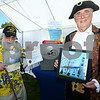 CARL RUSSO/Staff photo. Rick Holmes, left, Derry historian for 40 years, now retired and Dr. Michael Speidel of Windham as the ''Duke of Windham'' holding items that will go inside the 300th anniversary of Nutfield  time capsule (safe) including a letter from Buckingham Palace including warm regards from Queen Elizabeth of England.  <br /> <br /> The 30th annual Derryfest was held Saturday in MacGregor Park. The park was full of booths, entertainment on stage, businesses under tents etc. The  300th anniversary of Nutfield  time capsule and its contents was on display at the Derry Heritage Commission booth.  9/21/2019