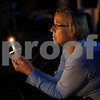 MIKE SPRINGER/Staff photo<br /> Mary Dow of Amesbury holds a candle during a suicide and addiction awareness vigil Thursday evening at MacGregor Park in Derry.<br /> 8/29/2019