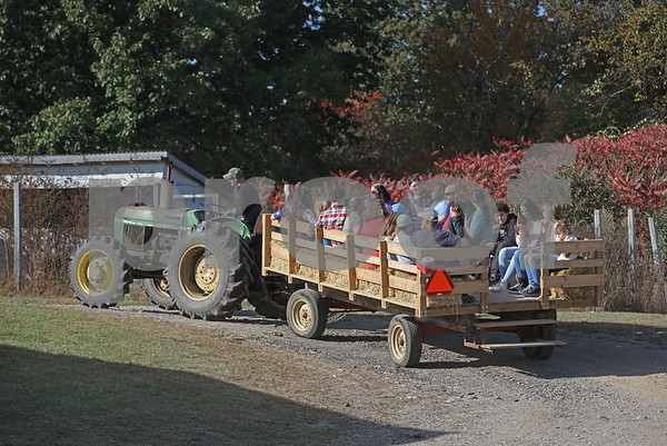 MIKE SPRINGER/Staff photo<br /> Families go for a hay ride Sunday at Elwood Orchards in Londonderry.<br /> 10/13/2019