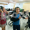 CARL RUSSO/Staff photo Alexis Davis, 7 and her twin brother, John try on computer head phones as they tour the Golden Brook School new library computer lab. They are second grade students. <br /> <br /> The ribbon cutting and dedication ceremony  for the Windham Golden Brook School and the Windham Middle School was held Tuesday evening. Invited guest including Richard Langlois, Superintendent of Windham Schools and Frank Edelblut, Commissioner of Education for New Hampshire addressed the audience during the ceremony. A reception and tour of both schools was held following the ceremony.  9/10/2019