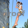 CARL RUSSO/Staff photo. DERRY NEWS: Cori Tekin, 7 of Derry climbs the rock wall. The 30th annual Derryfest was held Saturday in MacGregor Park. The park was full of booths, entertainment on stage, businesses under tents etc. The  300th anniversary of Nutfield  time capsule and its contents was on display at the Derry Heritage Commission booth.  9/21/2019