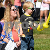 CARL RUSSO/Staff photo. DERRY NEWS: Lee Bouchard, 2 of Londonderry is ready for DerryFest with his balloon, hot dog bun (minus the dog) and sun glasses. He attended the event with his mother, Ashley, left and father, Joe (not seen). The 30th annual Derryfest was held Saturday in MacGregor Park. The park was full of booths, entertainment on stage, businesses under tents etc. The  300th anniversary of Nutfield  time capsule and its contents was on display at the Derry Heritage Commission booth.  9/21/2019