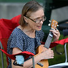CARL RUSSO/Staff photo Lori Grant of Derry sings while playing her ukulele. Derry Public Library hosted an outdoor ukulele program Wednesday night outside the library. 8/05/2020