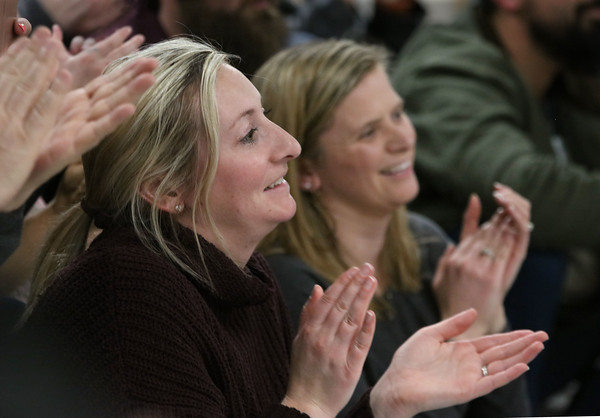 Jen Olson, left, and Maunie Royce applaud the performers during a 5th grade winter band concert last Wednesday at Derry Village Elementary School. <br /> 1/19/2020