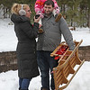 MIKE SPRINGER/Staff photo<br /> Alicia and Jason Carroll of Derry and their daughter Lena, 3, bring along a wooden sled while enjoying the day together Sunday during the 21st annual Frost Festival at Alexander-Carr Park in Derry.<br /> 2/16/2020