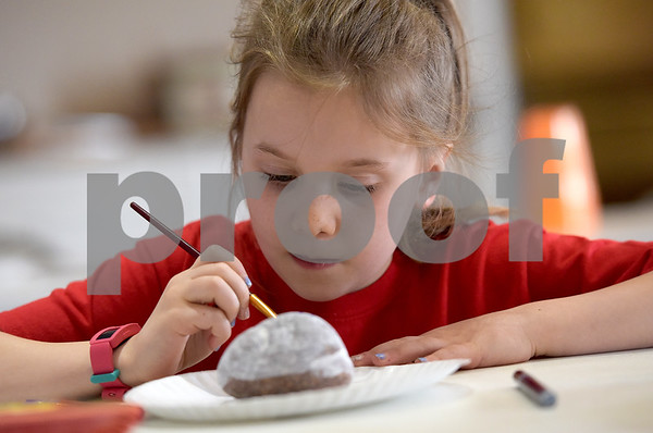 TIM JEAN/Staff photo <br /> <br /> Kennedy Rassbach, 7, of Derry, paints a rock during a Kindness Rocks project at First Parish Church in Derry, NH.   2/29/20