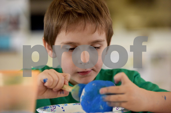 TIM JEAN/Staff photo <br /> <br /> William Robinson, 7, of Derry, paints a rock during a Kindness Rocks project at First Parish Church in Derry, NH.  2/29/20