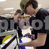TIM JEAN/Staff photo <br /> <br /> Londonderry's Artie Adams, 15, right, makes an adjustment on the teams robot in the pit area as team mentor Jim Browne, left, helps him during the FIRST Robotics New England Granite State District event held at Salem High School.   2/29/20