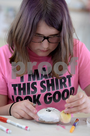 TIM JEAN/Staff photo <br /> <br /> Zoey Robinson, 10, of Derry, paints a rock during a Kindness Rocks project at First Parish Church in Derry, NH.  2/29/20