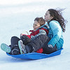 MIKE SPRINGER/Staff photo<br /> Siblings Leander, 7, and Aurelia Salce, 10, sled down the hill together Sunday during the 21st annual Frost Festival at Alexander-Carr Park in Derry.<br /> 2/16/2020