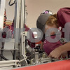 TIM JEAN/Staff photo <br /> <br /> Whittier Tech's Caleb Cook, 17, makes an adjustment on the teams robot in the pit area during the FIRST Robotics New England Granite State District event held at Salem High School.   2/29/20