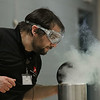 MIKE SPRINGER/Staff photo<br /> Jonah Sidman of the Museum of Science looks into a tank of liquid nitrogen during a presentation Tuesday on the states of matter for second graders at Derry Village Elementary School.<br /> 2/18/2020