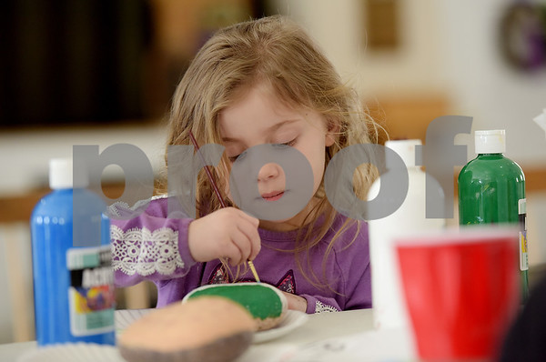 TIM JEAN/Staff photo <br /> <br /> Emma Lehoullier, 5, of Derry, paints a message on a rock during a Kindness Rocks project at First Parish Church in Derry, NH.   2/29/20