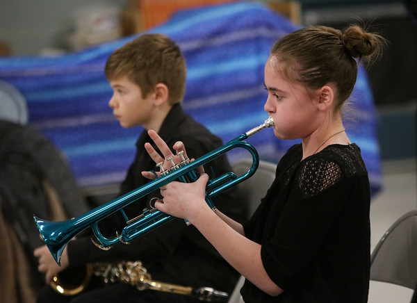 MIKE SPRINGER/Staff photo<br /> Hanna Bride plays the trumpet during a 5th grade winter band concert last Wednesday at Derry Village Elementary School. In the background is saxophonist Evan Royce.<br /> 1/19/2020