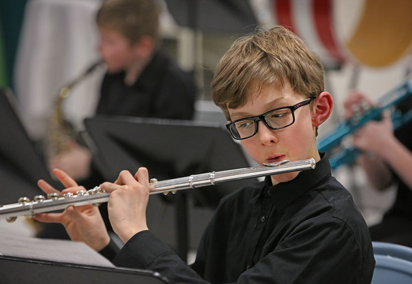 MIKE SPRINGER/Staff photo<br /> Alex Berthelotte plays the flute during a 5th grade winter band concert last Wednesday at Derry Village Elementary School. <br /> 1/19/2020