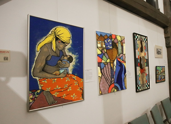 """MIKE SPRINGER/Staff photo<br /> Works by Nigerian-born painter Segun Olorunfemi of Manchester on display at the """"Our Neighbors, Ourselves"""" art exhibit at St. Peter's Episcopal Church in Londonderry.<br /> 2/27/2020"""