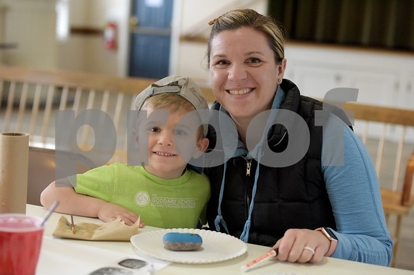 TIM JEAN/Staff photo <br /> <br /> Laurie Rassbach, of Derry, poses with her son Landon, 4, as they paint messages on a rock during a Kindness Rocks project at First Parish Church in Derry, NH.   2/29/20