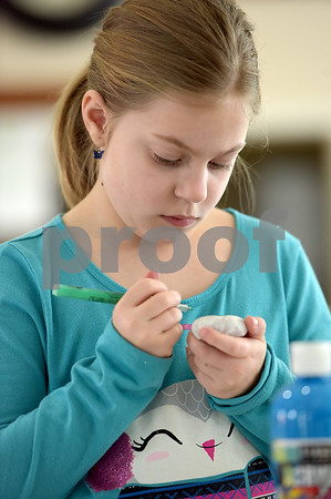 TIM JEAN/Staff photo <br /> <br /> Kylie Lehoullier, 9, of Derry, uses a paint pen to decorate a rock during a Kindness Rocks project at First Parish Church in Derry, NH. Families painted rocks with inspirational messages to later scatter around the church and community.   2/29/20