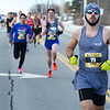 CARL RUSSO/staff photo. Warren Bartlett, 22 of Loudon N.H. stays in front all the way to capture first place with a time of 4:04.9. Bartlett, who has participated eight years in a row, ran his first race as a junior high student.<br /> <br /> The 21st. Annual New Year's Day Millennium Mile road race was held on New Year's Day at Londonderry high. Just over 1400 runners of all ages consisting of serious runners to family fun runners participated.  1/1/2020.