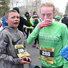 CARL RUSSO/staff photo. Londonderry's Jack Smith, 13, who place 24th. in the male 13-19 age group and Emily Smith, 14, who place 5th. in the female 13-19 age group catch their breath after crossing the finish line.  <br /> <br /> The 21st. Annual New Year's Day Millennium Mile road race was held on New Year's Day at Londonderry high. Just over 1400 runners of all ages consisting of serious runners to family fun runners participated.  1/1/2020.
