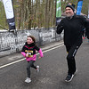 CARL RUSSO/staff photo. A father and daughter sprint across the finish line. <br /> <br /> The 21st. Annual New Year's Day Millennium Mile road race was held on New Year's Day at Londonderry high. 1/1/2020.