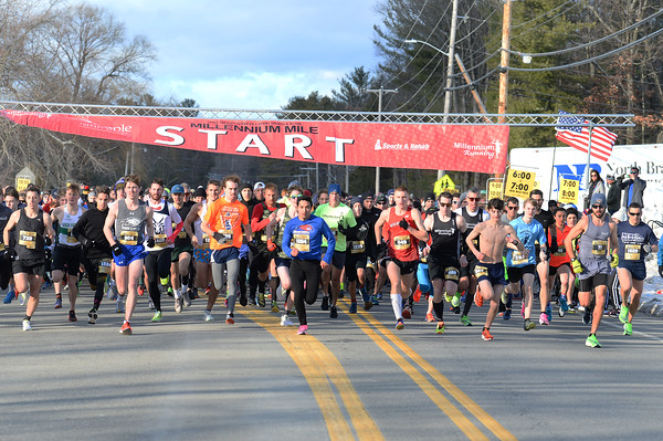 CARL RUSSO/staff photo. The start of the 21st. Annual New Year's Day Millennium Mile road race. Just over 1400 runners of all ages consisting of serious runners to family fun runners participated. 1/1/2020.