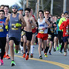 CARL RUSSO/staff photo. Londonderry's Christian Smith, 19, (#1227) stays close to the lead pack of runners. Warren Bartlett of Loudon (#71) stays in front all the way to capture first place  with a time of 4:04.9  <br /> <br /> The 21st. Annual New Year's Day Millennium Mile road race was held on New Year's Day at Londonderry high. Just over 1400 runners of all ages consisting of serious runners to family fun runners participated. 1/1/2020.
