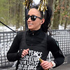 CARL RUSSO/staff photo. Rachel Morrow of Londonderry runs the race while still celebrating the new year. She finished 16th. in 35-39 division.  <br /> <br /> The 21st. Annual New Year's Day Millennium Mile road race was held on New Year's Day at Londonderry high. Just over 1400 runners of all ages consisting of serious runners to family fun runners participated. 1/1/2020.