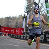 CARL RUSSO/staff photo. Warren Bartlett, 22 of Loudon N.H. crosses the finish line to capture first place with a time of 4:04.9. Bartlett, who has participated eight years in a row, ran his first race as a junior high student. <br /> <br /> The 21st. Annual New Year's Day Millennium Mile road race was held on New Year's Day at Londonderry high. Just over 1400 runners of all ages consisting of serious runners to family fun runners participated. 1/1/2020.