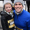 CARL RUSSO/staff photo. Andrew Toland of Manchester and his son Cormac, 5, had a fun time at the race.  <br /> <br /> The 21st. Annual New Year's Day Millennium Mile road race was held on New Year's Day at Londonderry high. Just over 1400 runners of all ages consisting of serious runners to family fun runners participated.1/1/2020.