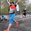 CARL RUSSO/staff photo. Kassandra Marin of Merrimack N.H. celebrates as she crosses the finish line to capture first place with a time of 4:54. <br /> <br /> The 21st. Annual New Year's Day Millennium Mile road race was held on New Year's Day at Londonderry high. Just over 1400 runners of all ages consisting of serious runners to family fun runners participated.  1/1/2020.
