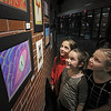 MIKE SPRINGER/Staff photo<br /> Third-graders, from left, Ella Gieryn, Charlotte Bayek and Katie Wiggins  look at the art during a Derry School District art show opening last Wednesday, March 4, at Pinkerton Academy.<br /> 3/4/2020