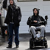 TIM JEAN/Staff photo<br /> <br /> Nathan Miner, 24, and his brother Branden Miner, 26, wave to vehicles as they pass them during a social distancing car parade of support for Branden, who was injured in a sledding accident earlier this year and returned home to Derry after rehab.     5/9/20