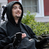 TIM JEAN/Staff photo<br /> <br /> Branden Miner, 26, is all smiles as vehicles drive pass him waving during a social distancing car parade of support for him who was injured in a sledding accident earlier this year and returned home to Derry after rehab.     5/9/20