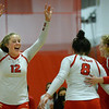 CARL RUSSO/Staff photo. Pinkerton Academy <br /> volleyball player, Ella Koelb, left, celebrates with her teammates, Aubrie Sansing, 8 and Reese Asselin. Pinkerton Academy  in volleyball action against Nashua South Thursday afternoon. 10/01/2020