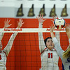 CARL RUSSO/Staff photo. Pinkerton's Sarah Taylor, left and  Liliy-Anne Heywood double team on defense. Pinkerton Academy in volleyball action against Nashua South Thursday afternoon. 10/01/2020