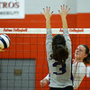 CARL RUSSO/Staff photo. Pinkerton's Morgan Stevens spikes the ball over the net. Pinkerton Academy  in volleyball action against Nashua South Thursday afternoon. 10/01/2020