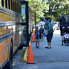 TIM JEAN/Staff photo<br /> <br /> Teachers at Grinnell Elementary School help students as they get off busses on the first day of school in Derry, NH.   8/31/20