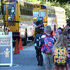 TIM JEAN/Staff photo<br /> <br /> Mary Hill, Principal Grinnell Elementary School gestures to student to follow her as they get off busses on the first day of school in Derry, NH.   8/31/20