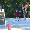 TIM JEAN/Staff photo<br /> <br /> Crossing guard Katie Skoog, a Speech and Language Pathologist helps a student cross after being dropped of by his parents on the first day of school at Grinnell Elementary School in Derry, NH.   8/31/20