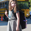 TIM JEAN/Staff photo<br /> <br /> Second grader Stella Stillman gives a thumbs-up as she arrives on the first day of school at Grinnell Elementary School in Derry, NH.   8/31/20